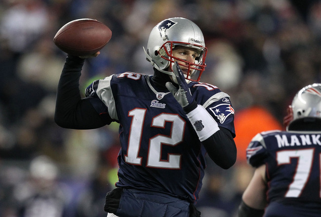 FOXBORO, MA - JANUARY 16:  Quarterback Tom Brady #12 of the New England Patriots throws a pass during their 2011 AFC divisional playoff game against the New York Jets at Gillette Stadium on January 16, 2011 in Foxboro, Massachusetts.  (Photo by Al Bello/G
