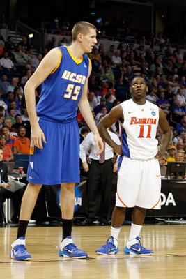 TAMPA, FL - MARCH 17:  Erving Walker #11 of the Florida Gators looks up at Greg Somogyi #55 of the UC Santa Barbara Gauchos during the second round of the 2011 NCAA men's basketball tournament at St. Pete Times Forum on March 17, 2011 in Tampa, Florida. F