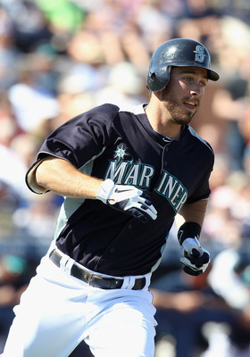 PEORIA, AZ - MARCH 04:  Dustin Ackley #13 of the Seattle Mariners runs to first base during the spring training game against the Cincinnati Reds at Peoria Stadium on March 4, 2011 in Peoria, Arizona.  (Photo by Christian Petersen/Getty Images)