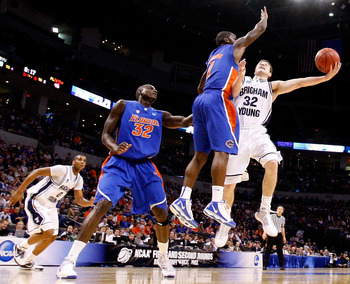 OKLAHOMA CITY - MARCH 18:  Jimmer Fredette #32 of the BYU Cougars drives for a shot attempt against Kenny Boynton #1 of the Florida Gators during the first round of the 2010 NCAA men�s basketball tournament at Ford Center on March 18, 2010 in Oklahoma Cit