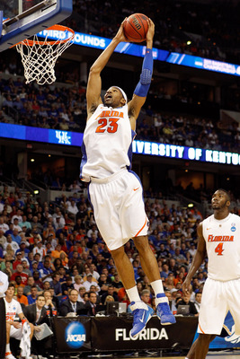TAMPA, FL - MARCH 19:  Alex Tyus #23 of the Florida Gators grabs a rebound agains the UCLA Bruins during the third round of the 2011 NCAA men's basketball tournament at St. Pete Times Forum on March 19, 2011 in Tampa, Florida. Florida won 73-65. (Photo by