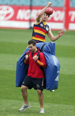 ADELAIDE, AUSTRALIA - AUGUST 21:  Andy Otten jumps for the ball during an Adelaide Crows AFL training session at AAMI stadium on August 21, 2009 in Adelaide, Australia.  (Photo by James Knowler/Getty Images)
