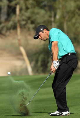 DUBAI, UNITED ARAB EMIRATES - FEBRUARY 03:  Paul Casey of England plays out of a divot at the 17th hole during the pro-am as a preview for the 2010 Omega Dubai Desert Classic on the Majilis Course at the Emirates Golf Club on February 3, 2010 in Dubai, Un