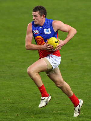 PERTH, AUSTRALIA - AUGUST 07:  Tom Rockliff of the Lions runs with the ball during the round 19 AFL match between the West Coast Eagles and the Brisbane Lions at Subiaco Oval on August 7, 2010 in Perth, Australia.  (Photo by Paul Kane/Getty Images)