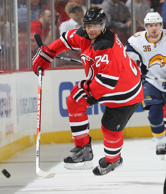 NEWARK, NJ - APRIL 11: Bryce Salvador #24 of the New Jersey Devils chases the puck against the Buffalo Sabres at the Prudential Center on April 11, 2010 in Newark, New Jersey.  (Photo by Chris McGrath/Getty Images)