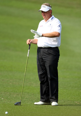 HONG KONG - NOVEMBER 19: Colin Montgomerie of Scotland asks the spectators to keep quiet on the 3rd hole  during day two of the UBS Hong Kong Open at The Hong Kong Golf Club on November 19, 2010 in Hong Kong, Hong Kong. ( Photo by Stanley Chou/Getty Image