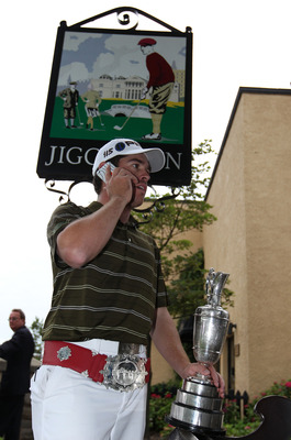 ST ANDREWS, SCOTLAND - JULY 18:  Louis Oosthuizen of South Africa chats on a mobile phone outside the Jigger Inn on the Old Course, St Andrews on July 18, 2010 in St Andrews, Scotland.  (Photo by Ross Kinnaird/Getty Images)