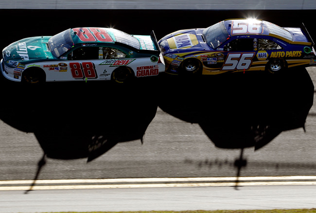 DAYTONA BEACH, FL - FEBRUARY 20:  Dale Earnhardt Jr., driver of the #88 National Guard/AMP Energy Chevrolet, and Martin Truex Jr., driver of the #56 NAPA Toyota, race during the NASCAR Sprint Cup Series Daytona 500 at Daytona International Speedway on Feb