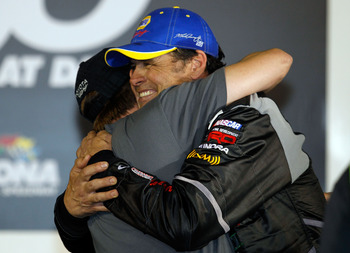 DAYTONA BEACH, FL - FEBRUARY 18:  Michael Waltrip (R), driver of the #15 NASCAR RACE View/Wounded Warrior Project Toyota, hugs driver David Reutimann (L) in Victory Lane after winning the NASCAR Camping World Truck Series NextEra Energy Resources 250 at D