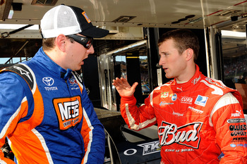 ROSSBURG, OH - JUNE 09:  Kyle Busch,driver of the #18 NOS Energy late model Toyota, talks with Kasey Kahne, driver of the #9 Budweiser late model Ford, prior to the Gillette Fusion ProGlide Prelude to the Dream at Eldora Speedway on June 9, 2010 in Rossbu