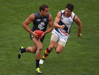 MELBOURNE, AUSTRALIA - MARCH 04: Chris Yarran of the Blues runs from his opponent during the NAB Challenge AFL match between the Carlton Blues and the Adelaide Crows at Visy Park on March 4, 2011 in Melbourne, Australia.  (Photo by Robert Cianflone/Getty