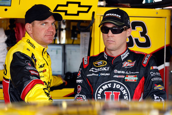 AVONDALE, AZ - FEBRUARY 25:  Clint Bowyer, driver of the #33 Cheerios Chevrolet, and Kevin Harvick, driver of the #29 Jimmy John's Chevrolet, stand in the garage area during practice for the Subway Fresh Fit 500 at Phoenix International Raceway on Februar