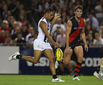 MELBOURNE, AUSTRALIA - MARCH 11: Andrew Krakouer of the Magpies kicks for goal during the NAB Cup AFL Grand Final match between the Essendong Bombers and the Collingwood Magpies at Etihad Stadium on March 11, 2011 in Melbourne, Australia.  (Photo by Rober