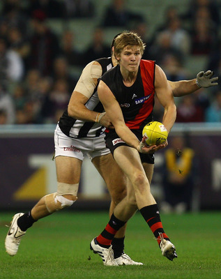 MELBOURNE, AUSTRALIA - AUGUST 13:  Michael Hurley of the Bombers handballs during the round 20 AFL match between the Essendon Bombers and the Collingwood Magpies at Melbourne Cricket Ground on August 13, 2010 in Melbourne, Australia.  (Photo by Quinn Roon