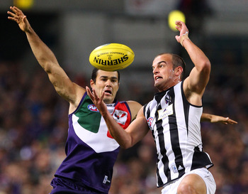 PERTH, AUSTRALIA - MAY 14:  Chris Tarrant of the Dockers and John Anthony of the Magpies contest a mark during the round eight AFL match between the Fremantle Dockers and the Collingwood Magpies at Subiaco Oval on May 14, 2010 in Perth, Australia.  (Photo