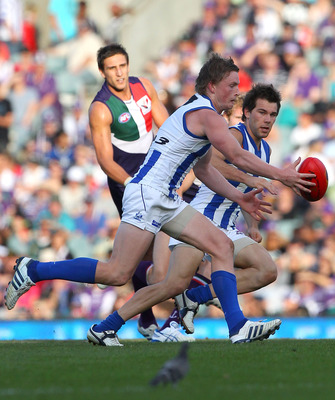 PERTH, AUSTRALIA - MAY 30:  Jack Ziebell of the Kangaroos gathers the ball during the round 10 AFL match between the Fremantle Dockers and the North Melbourne Kangaroos at Subiaco Oval on May 30, 2010 in Perth, Australia.  (Photo by Paul Kane/Getty Images