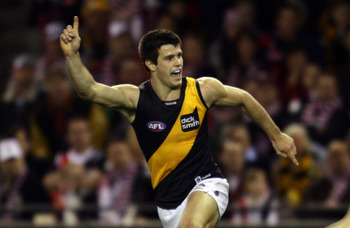 MELBOURNE, AUSTRALIA - AUGUST 21:  Trent Cotchin of the Tigers celebrates after kicking a goal during the round 21 AFL match between the St Kilda Saints and the Richmond Tigers at Etihad Stadium on August 21, 2010 in Melbourne, Australia.  (Photo by Scott