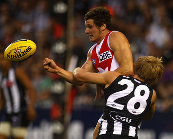 MELBOURNE, AUSTRALIA - FEBRUARY 25:   Andrejs Everitt of the Swans is tackled by Ben Sinclair of the Magpies during the NAB Cup Quarter Final match between the Collingwood Magpies and the Sydney Swans at Etihad Stadium on February 25, 2011 in Melbourne, A