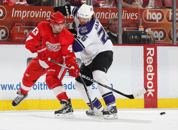 DETROIT, MI - MARCH 9:  Michal Handzus #26 of the Los Angeles Kings tries to check Darren Helm #43 of the Detroit Red Wings before he can get a pass away in a game on March 9, 2011 at the Joe Louis Arena in Detroit, Michigan. The Kings defeated the Wings
