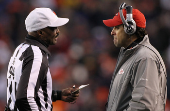 DENVER - NOVEMBER 14:  Head coach Todd Haley of the Kansas City Chiefs questions a video replay call with referee Mike Carey on a touchdown by Brandon Lloyd of the Denver Broncos at INVESCO Field at Mile High on November 14, 2010 in Denver, Colorado. The