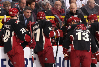 GLENDALE, AZ - MARCH 22:  Head coach Dave Tippett of the Phoenix Coyotes speaks with his team during a time out from the NHL game against the St. Louis Blues at Jobing.com Arena on March 22, 2011 in Glendale, Arizona. The Coyotes defeated the Blues 2-1.