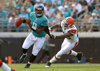 JACKSONVILLE, FL - NOVEMBER 21:  David Garrard #9  of the Jacksonville Jaguars is chased down by Marcus Bernard #58 during a game agaisnt the Cleveland Browns at EverBank Field on November 21, 2010 in Jacksonville, Florida.  (Photo by Mike Ehrmann/Getty I
