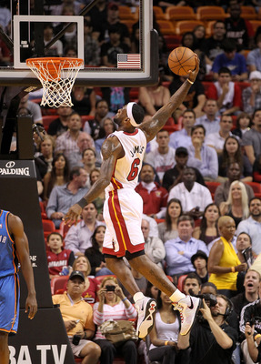 MIAMI, FL - MARCH 16: LeBron James #6 of the Miami Heat dunks during a game against the Oklahoma City Thunder at American Airlines Arena on March 16, 2011 in Miami, Florida. NOTE TO USER: User expressly acknowledges and agrees that, by downloading and/or