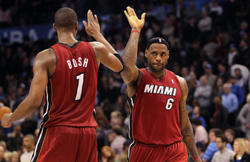 OKLAHOMA CITY, OK - JANUARY 30:  Forward LeBron James #6 and Chris Bosh #1 of the Miami Heat celebrate after a 108-103 win against the Oklahoma City Thunder at Ford Center on January 30, 2011 in Oklahoma City, Oklahoma.  NOTE TO USER: User expressly ackno