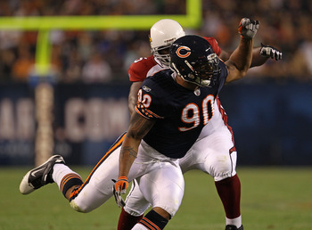 CHICAGO - AUGUST 28: Julius Peppers #90 of the Chicago Bears rushes past Levi Brown #75 of the Arizona Cardinals during a preseason game at Soldier Field on August 28, 2010 in Chicago, Illinois. (Photo by Jonathan Daniel/Getty Images)