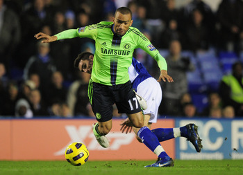 BIRMINGHAM, ENGLAND - NOVEMBER 20:  Jose Bosingwa of Chelsea falls under the challenge by Liam Ridgewell of Birmingham City during the Barclays Premier League match between Birmingham City and Chelsea at St Andrews on November 20, 2010 in Birmingham, Engl