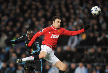 MARSEILLE, FRANCE - FEBRUARY 23:  Dimitar Berbatov of Manchester United is challenged by  Souleymane Diawara of Marseille during the UEFA Champions League round of 16 first leg match between Marseille and Manchester United at the Stade Velodrome on Februa