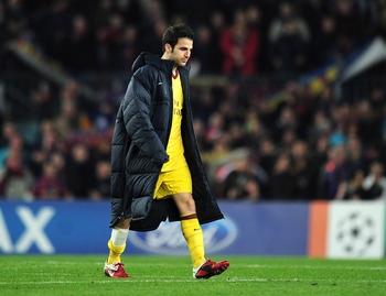BARCELONA, SPAIN - MARCH 08:  Cesc Fabregas of Arsenal leaves the field at the end of the UEFA Champions League round of 16 second leg match between Barcelona and Arsenal at the Nou Camp Stadium on March 8, 2011 in Barcelona, Spain.  (Photo by Shaun Botte