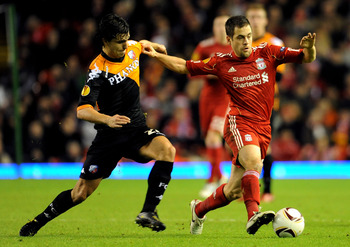 LIVERPOOL, ENGLAND - DECEMBER 15:  Joe Cole of Liverpool is challenged by Gianluca Nijholt of FC Utrecht during the UEFA Europa League Group K match between Liverpool and FC Utrecht at Anfield on December 15, 2010 in Liverpool, England.  (Photo by Clint H