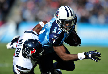 NASHVILLE, TN - DECEMBER 19:  Damian Williams #17 of the Tennessee Titans makes a catch as Eugene Wilson #26 of the Houston Texans defends during the first half at LP Field on December 19, 2010 in Nashville, Tennessee.  (Photo by Grant Halverson/Getty Ima