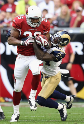 GLENDALE, AZ - DECEMBER 05:  Runningback Beanie Wells #26 of the Arizona Cardinals rushes the football against Ronald Bartell #24 of the St. Louis Rams during the NFL game at the University of Phoenix Stadium on December 5, 2010 in Glendale, Arizona.  The