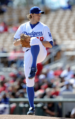 PHOENIX, AZ - FEBRUARY 27:  John Ely #48 of the Los Angeles Dodgers pitches against the  Los Angeles Angels in the first inning during spring training at Camelback Ranch on February 27, 2011 in Phoenix, Arizona.  (Photo by Harry How/Getty Images)