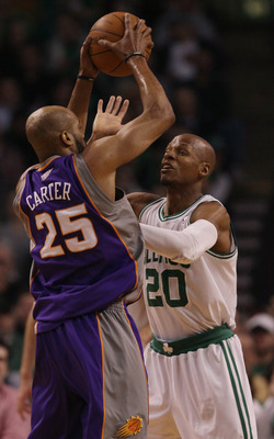 BOSTON, MA - MARCH 02:  Ray Allen #20 of the Boston Celtics defends as Vince Carter #25 of the Phoenix Suns tries to pass the ball on March 2, 2011 at the TD Garden in Boston, Massachusetts.  NOTE TO USER: User expressly acknowledges and agrees that, by d
