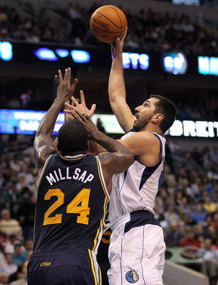 DALLAS, TX - FEBRUARY 23:  Forward Peja Stojakovic #16 of the Dallas Mavericks takes a shot against Paul Millsap #24 of the Utah Jazz at American Airlines Center on February 23, 2011 in Dallas, Texas.  NOTE TO USER: User expressly acknowledges and agrees