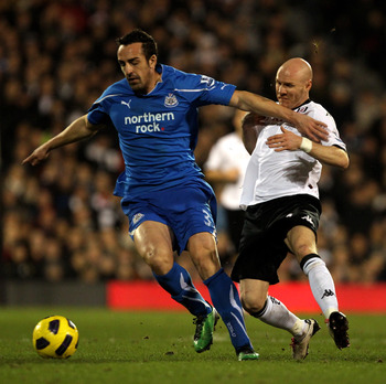 LONDON, ENGLAND - FEBRUARY 02:  Jose Enrique Sanchez (L) of Newcastle battles with Andrew Johnson of Fulham during the Barclays Premier League match between Fulham and Newcastle United at Craven Cottage on February 2, 2011 in London, England.  (Photo by C