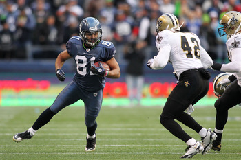 SEATTLE, WA - JANUARY 08:  Golden Tate #81 of the Seattle Seahawks runs down field against Darren Sharper #42 of the New Orleans Saints during the 2011 NFC wild-card playoff game at Qwest Field on January 8, 2011 in Seattle, Washington.  (Photo by Jonatha