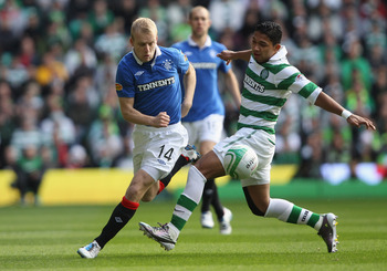 GLASGOW, SCOTLAND - OCTOBER 24: Steven Naismith of Rangers is tackled by Emilio Izaguirre of Celtic during the Clydesdale Bank Premier League match between Celtic and Rangers at Celtic Park on October 24, 2010 in Glasgow, Scotland.  (Photo by Clive Brunsk