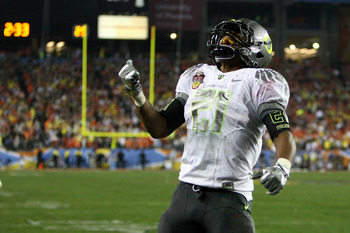 GLENDALE, AZ - JANUARY 10:  LaMichael James #21 of the Oregon Ducks reacts during their game against the Auburn Tigers during the Tostitos BCS National Championship Game at University of Phoenix Stadium on January 10, 2011 in Glendale, Arizona.  (Photo by