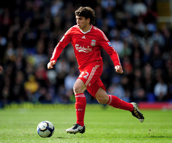 BIRMINGHAM, ENGLAND - APRIL 04:  Emiliano Insua of Liverpool in action during the Barclays Premier League match between Birmingham City and Liverpool at St. Andrews Stadium on April 4, 2010 in Birmingham, England.  (Photo by Shaun Botterill/Getty Images)