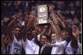 MINNEAPOLIS, MN - APRIL 6:  Head coach Mike Krzyzewski and his Duke Blue Devils revel in their glory after winning their second consecetive NCAA basketball championship by beating the Michigan Wolverines on April 6, 1992 at the Hubert H. Humphrey Metrodom