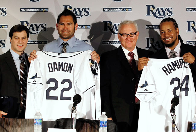 ST PETERSBURG, FL - FEBRUARY 01:  (L to R)  Executive Vice President of Baseball Operations Andrew Friedman, Johnny Damon #22 of the Tampa Bay Rays, Tampa Bay Rays manager Joe Maddon and Manny Ramirez #24 of the Tampa Bay Rays pose for a photo during a pr