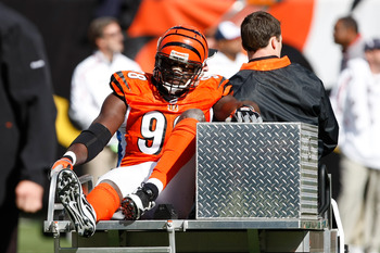 CINCINNATI, OH - OCTOBER 18: Defensive end Antwan Odem #98 of the Cincinnati Bengals is taken off the field on a cart after an injury against the Houston Texans at Paul Brown Stadium on October 18, 2009 in Cincinnati, Ohio. (Photo by Scott Boehm/Getty Ima