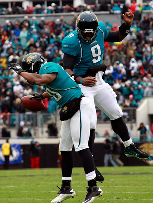 JACKSONVILLE, FL - DECEMBER 26: Quarterback David Garrard #9 and Mike Thomas #80 of the jacksonville Jaguars celebrate following a touchdown during the game against the Washington Redskins at EverBank Field on December 26, 2010 in Jacksonville, Florida.