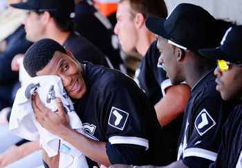PHOENIX, AZ - MARCH 17:  Pitcher Edwin Jackson #33 of the Chicago White Sox wipes his face after giving four runs to the Milwaukee Brewers during the first inning of the spring training game at Maryvale Baseball Park on March 17, 2011 in Phoenix, Arizona.