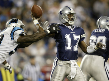 CHARLOTTE, NC - JANUARY 3:  Quincy Carter #17 of the Dallas Cowboys is hit by a Carolina Panthers defender while throwing a pass during their NFC Wildcard playoff game on January 3, 2004 at Ericsson Stadium in Charlotte, North Carolina.  (Photo By Craig J