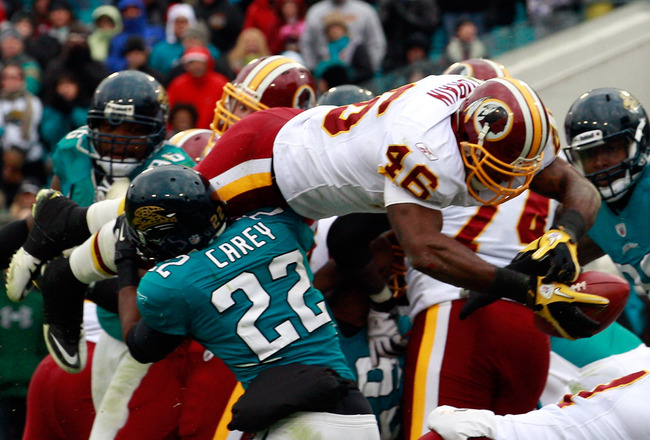 JACKSONVILLE, FL - DECEMBER 26:  Ryan Torain #46 of the Washington Redskins dives for a touchdown over Don Carey #22 of the Jacksonville Jaguars during the game at EverBank Field on December 26, 2010 in Jacksonville, Florida.  (Photo by Sam Greenwood/Gett